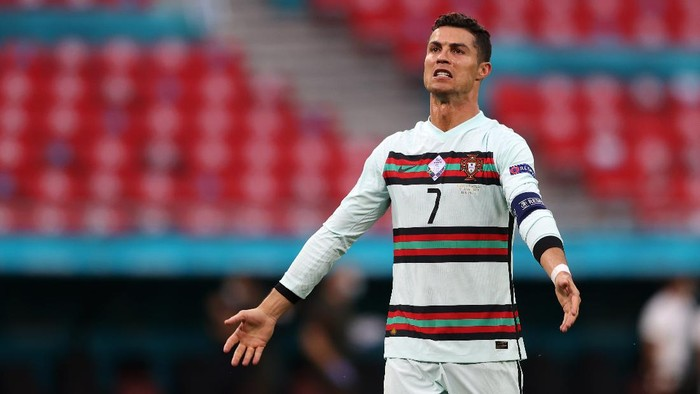 BUDAPEST, HUNGARY - JUNE 15: Cristiano Ronaldo of Portugal celebrates after victory in the UEFA Euro 2020 Championship Group F match between Hungary and Portugal at Puskas Arena on June 15, 2021 in Budapest, Hungary. (Photo by Alex Pantling/Getty Images)