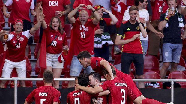 Denmark teammates celebrate after scoring their side's first goal during the Euro 2020 soccer championship group B match between Denmark and Belgium at Parken stadium in Copenhagen, Thursday, June 17, 2021. (Friedemann Vogel/Pool via AP)