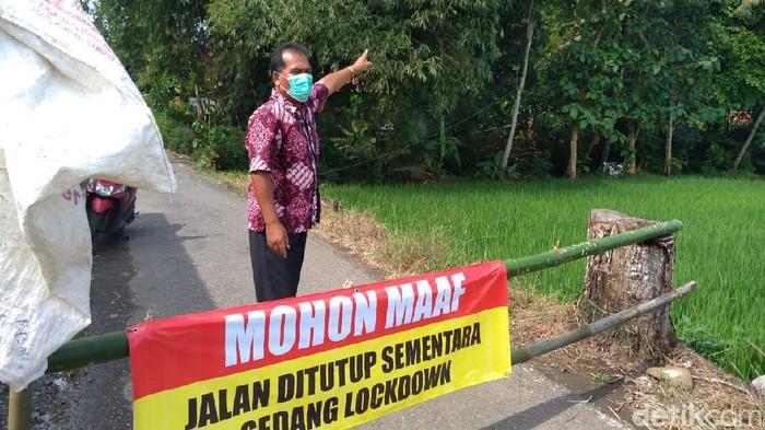 Desa Manduraga di Kecamatan Kalimanah, Kabupaten Purbalingga, Jawa Tengah, menerapkan lockdown mulai Rabu (16/6) malam usai 20 warganya positif COVID-19.
