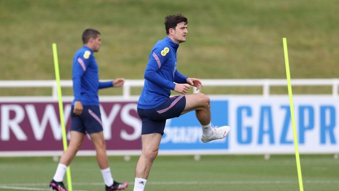 BURTON UPON TRENT, ENGLAND - JUNE 14: Harry Maguire of England warms up during the England Training Session at St Georges Park on June 14, 2021 in Burton upon Trent, England. (Photo by Catherine Ivill/Getty Images)