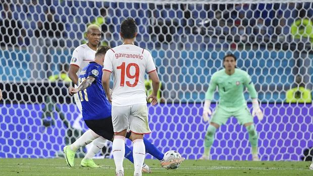 Italy's Ciro Immobile, center, scores his side's third goal during the Euro 2020 soccer championship group A match between Italy and Switzerland at Olympic stadium in Rome, Wednesday, June 16, 2021. (Ettore Ferrari, Pool via AP)