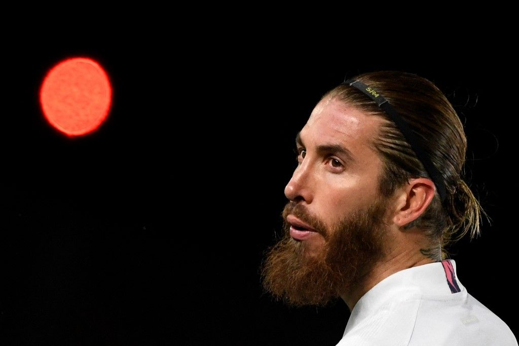 (FILES) In this file photo taken on March 16, 2021 Real Madrid's Spanish defender Sergio Ramos looks on during the UEFA Champions League round of 16 second leg football match between Real Madrid CF and Atalanta at the Alfredo di Stefano stadium in Valdebebas, on the outskirts of Madrid. - Legendary captain Sergio Ramos is to leave Real Madrid after a glittering, trophy-laden career spanning 671 games and 16 seasons, the club announced on June 16, 2021. (Photo by PIERRE-PHILIPPE MARCOU / AFP)