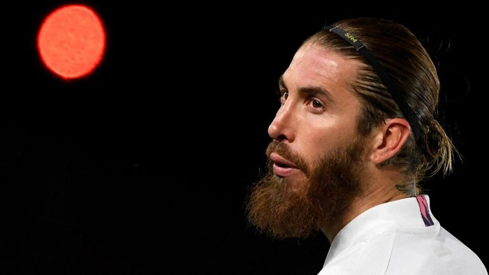 (FILES) In this file photo taken on March 16, 2021 Real Madrids Spanish defender Sergio Ramos looks on during the UEFA Champions League round of 16 second leg football match between Real Madrid CF and Atalanta at the Alfredo di Stefano stadium in Valdebebas, on the outskirts of Madrid. - Legendary captain Sergio Ramos is to leave Real Madrid after a glittering, trophy-laden career spanning 671 games and 16 seasons, the club announced on June 16, 2021. (Photo by PIERRE-PHILIPPE MARCOU / AFP)