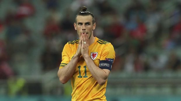 Wales' Gareth Bale reacts after a missed a penalty shot during the Euro 2020 soccer championship group A match between Turkey and Wales at at the Baku Olympic Stadium in Baku, Wednesday, June 16, 2021. (Tolga Bozoglu/Pool Photo via AP)