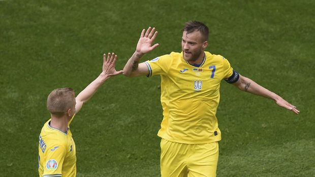 Ukraine's Andriy Yarmolenko, right, celebrates after scoring his side's opening goal during the Euro 2020 soccer championship group C match between Ukraine and North Macedonia at the National Arena stadium in Bucharest, Romania, Thursday, June 17, 2021. (AP Photo/Mihai Barbu, Pool)