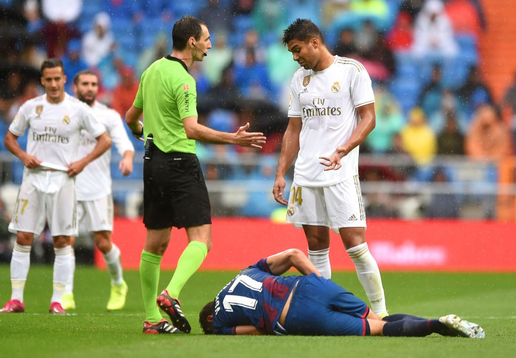 MADRID, SPAIN - SEPTEMBER 14: Casemiro of Real Madrid reacts after a tackle on Nikola Vukcevic of Levante UD during the La Liga match between Real Madrid CF and Levante UD at Estadio Santiago Bernabeu on September 14, 2019 in Madrid, Spain. (Photo by Denis Doyle/Getty Images)