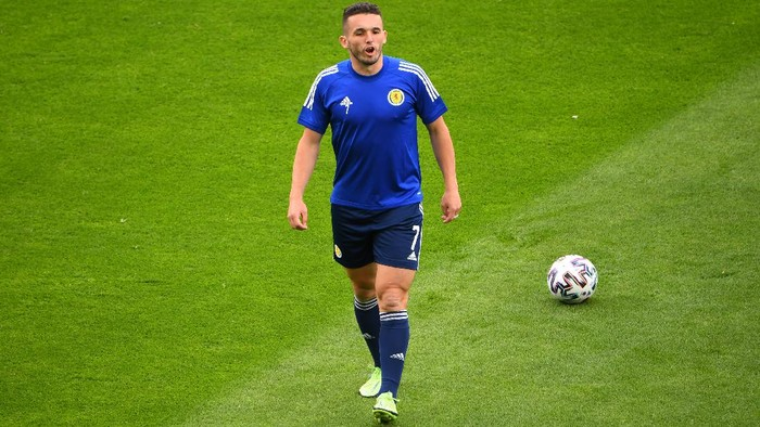 GLASGOW, SCOTLAND - JUNE 14: John McGinn of Scotland warms up prior to the UEFA Euro 2020 Championship Group D match between Scotland v Czech Republic at Hampden Park on June 14, 2021 in Glasgow, Scotland. (Photo by Andy Buchanan - Pool/Getty Images)