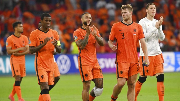 The Netherlands players celebrates after winning the Euro 2020 soccer championship group C match between the The Netherlands and Austria at Johan Cruijff ArenA in Amsterdam, Netherlands, Thursday, June 17, 2021. (John Thys, Pool via AP)