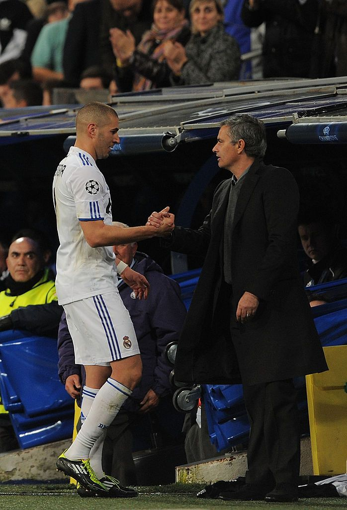 MADRID, SPAIN - MARCH 16:  Karim Benzema of Real Madrid shakes hands with head coach Jose Mourinho after being substituted during the UEFA Champions League round of 16 second leg match between Real Madrid and Lyon at Estadio Santiago Bernabeu on March 16, 2011 in Madrid, Spain.  (Photo by Denis Doyle/Getty Images)