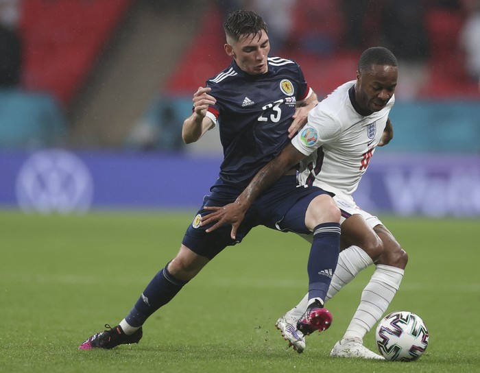 Scotlands Billy Gilmour, left, and Englands Phil Foden vie for the ball during the Euro 2020 soccer championship group D match between England and Scotland at Wembley stadium in London, Friday, June 18, 2021. (Carl Recine/Pool Photo via AP)