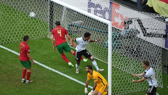 MUNICH, GERMANY - JUNE 19: Serge Gnabry of Germany celebrates their sides second goal, an own goal by Raphael Guerreiro of Portugal during the UEFA Euro 2020 Championship Group F match between Portugal and Germany at Football Arena Munich on June 19, 2021 in Munich, Germany. (Photo by Matthias Hangst/Getty Images)