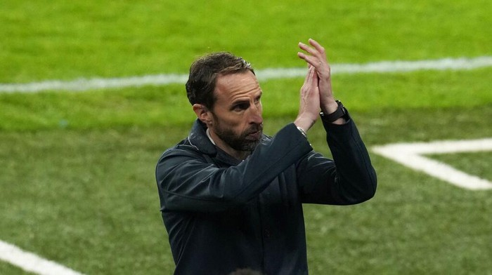 Englands manager Gareth Southgate applauds as he leaves the pitch during the Euro 2020 soccer championship group D match between England and Scotland, at Wembley stadium, in London, Friday, June 18, 2021. The match ended 0-0. (AP Photo/Matt Dunham, Pool)