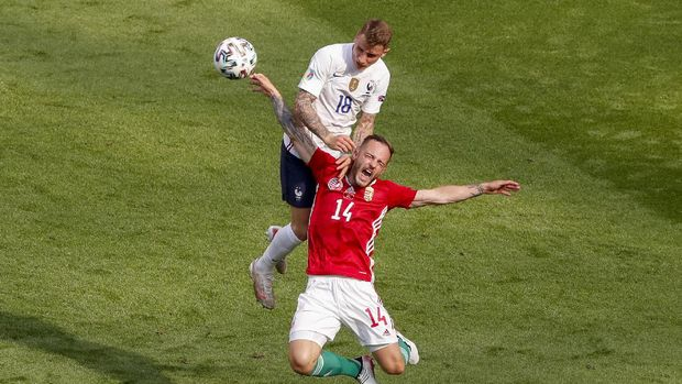Hungary's Gergo Lovrencsics and France's Lucas Digne, top, battle for the ball during the Euro 2020 soccer championship group F match between Hungary and France at the Ferenc Puskas stadium in Budapest, Hungary, Saturday, June 19, 2021. (AP Photo/Laszlo Balogh,Pool)