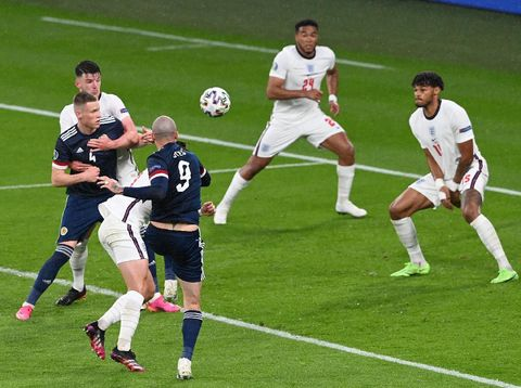 LONDON, ENGLAND - JUNE 18: Lyndon Dykes of Scotland has a header blocked by Reece James of England during the UEFA Euro 2020 Championship Group D match between England and Scotland at Wembley Stadium on June 18, 2021 in London, England. (Photo by Facundo Arrizabalaga - Pool/Getty Images)