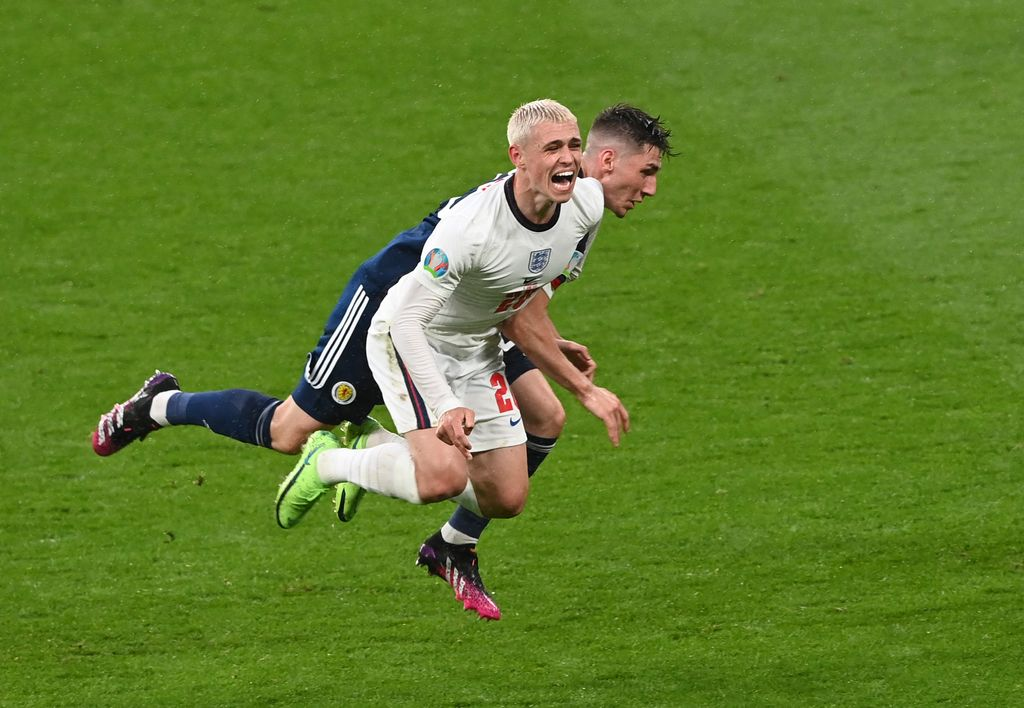 LONDON, ENGLAND - JUNE 18: Phil Foden of England is challenged by Billy Gilmour of Scotland during the UEFA Euro 2020 Championship Group D match between England and Scotland at Wembley Stadium on June 18, 2021 in London, England. (Photo by Facundo Arrizabalaga - Pool/Getty Images)