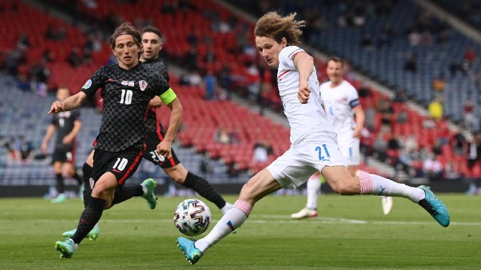 GLASGOW, SCOTLAND - JUNE 18: Alex Kral of Czech Republic shoots whilst under pressure from Luka Modric of Croatia during the UEFA Euro 2020 Championship Group D match between Croatia and Czech Republic at Hampden Park on June 18, 2021 in Glasgow, Scotland. (Photo by Stu Forster/Getty Images)