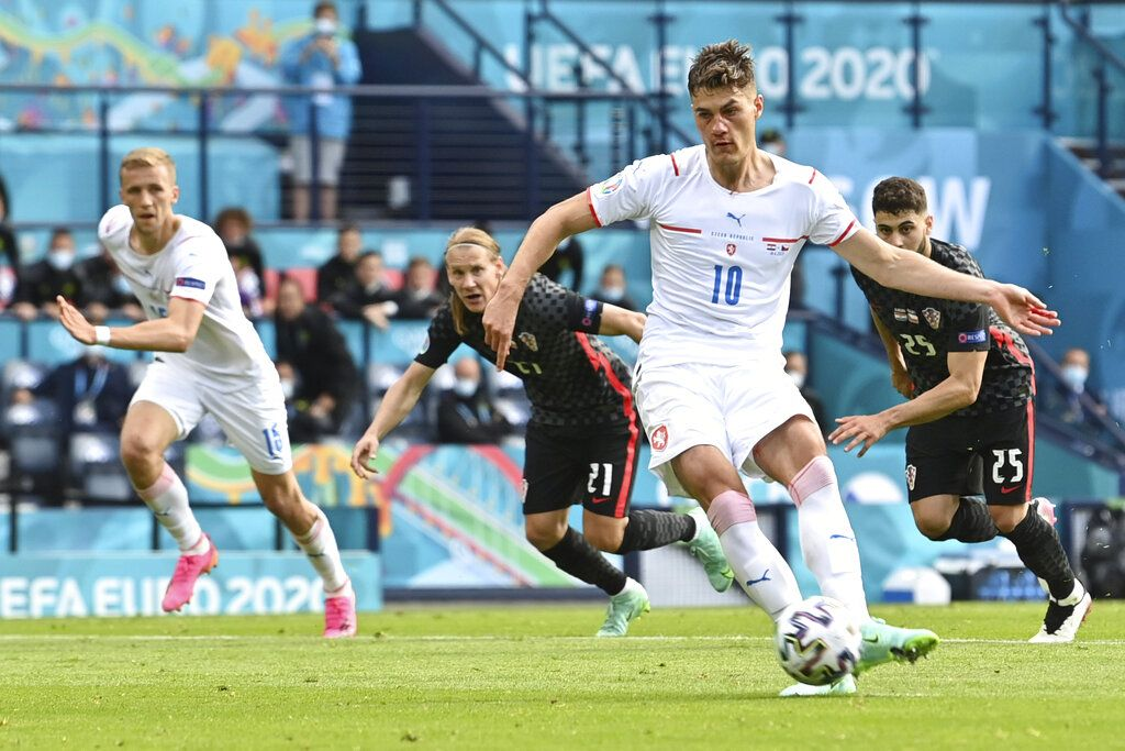 Czech Republic's Patrik Schick scores his side's first goal rom the penalty spot during the Euro 2020 soccer championship group D match between Croatia and the Czech Republic at the Hampden Park stadium in Glasgow, Friday, June 18, 2021. (Paul Ellis, Pool via AP)