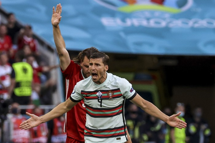 Portugals Ruben Dias argues during the Euro 2020 soccer championship group F match between Hungary and Portugal at the Ferenc Puskas stadium in Budapest, Hungary, Tuesday, June 15, 2021. (Bernadett Szabo/Pool via AP)