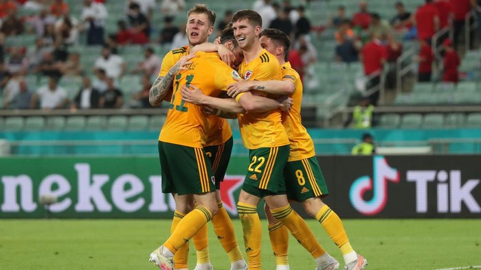 BAKU, AZERBAIJAN - JUNE 16: Chris Mepham of Wales celebrates with team mates after their sides second goal scored by Connor Roberts (Not pictured) during the UEFA Euro 2020 Championship Group A match between Turkey and Wales at Baku Olimpiya Stadionu on June 16, 2021 in Baku, Azerbaijan. (Photo by Tolga Bozoglu - Pool/Getty Images)