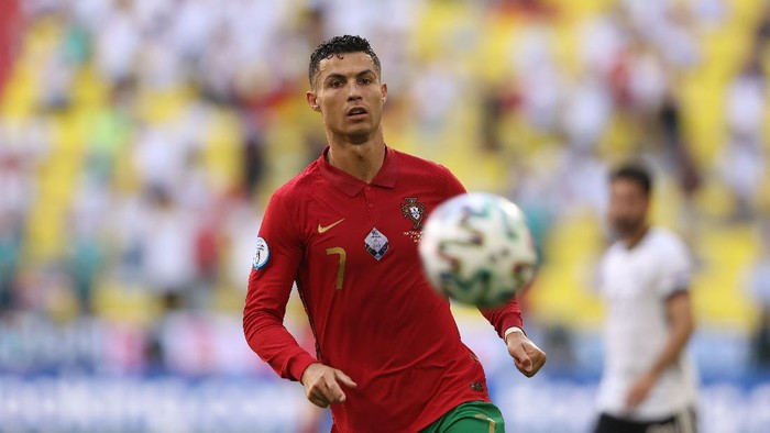 MUNICH, GERMANY - JUNE 19: Cristiano Ronaldo of Portugal runs with the ball during the UEFA Euro 2020 Championship Group F match between Portugal and Germany at Football Arena Munich on June 19, 2021 in Munich, Germany. (Photo by Alexander Hassenstein/Getty Images)