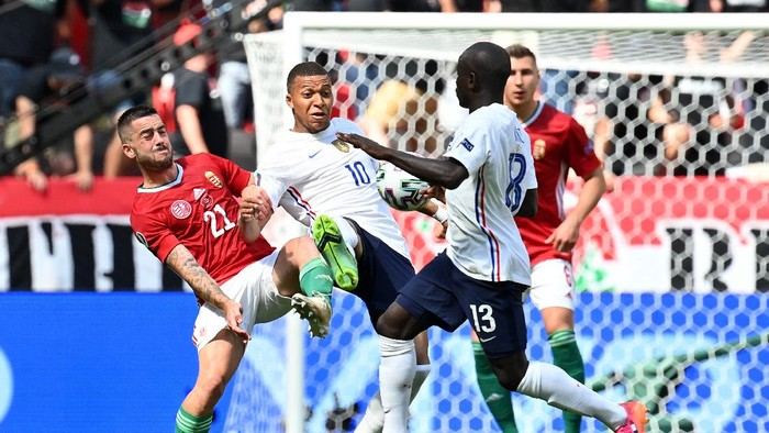 BUDAPEST, HUNGARY - JUNE 19: Kylian Mbappe of France battles for possession with Endre Botka of Hungary during the UEFA Euro 2020 Championship Group F match between Hungary and France at Puskas Arena on June 19, 2021 in Budapest, Hungary. (Photo by Tibor Illyes - Pool/Getty Images)