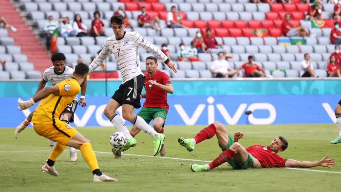 MUNICH, GERMANY - JUNE 19: Kai Havertz of Germany scores their sides third goal past Rui Patricio of Portugal during the UEFA Euro 2020 Championship Group F match between Portugal and Germany at Football Arena Munich on June 19, 2021 in Munich, Germany. (Photo by Alexander Hassenstein/Getty Images)