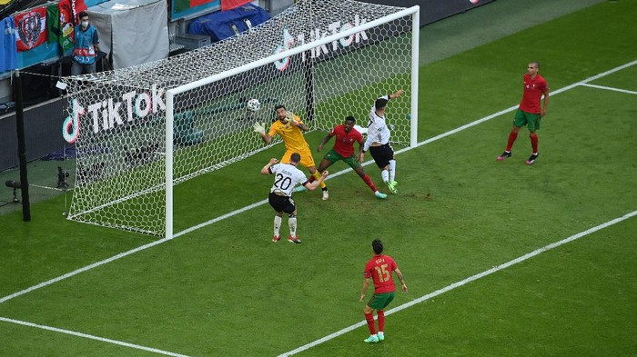 MUNICH, GERMANY - JUNE 19: Robin Gosens of Germany scores their sides fourth goal past Rui Patricio of Portugal during the UEFA Euro 2020 Championship Group F match between Portugal and Germany at Football Arena Munich on June 19, 2021 in Munich, Germany. (Photo by Matthias Hangst/Getty Images)