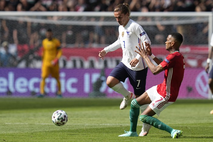 Frances Antoine Griezmann is challenged by Hungarys Loic Nego, right, during the Euro 2020 soccer championship group F match between Hungary and France, at the Ferenc Puskas stadium in Budapest, Saturday, June 19, 2021. (AP Photo/Darko Bandic, Pool)