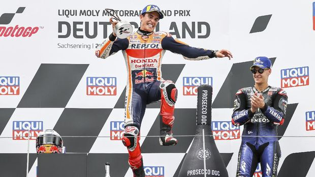 Rider Marc Marquez from Spain of the Repsol Honda Team reacts after winning the Moto GP race at the Sachsenring circuit in Hohenstein-Ernstthal, Germany, Sunday, June 20, 2021. (Jan Woitas/dpa via AP)