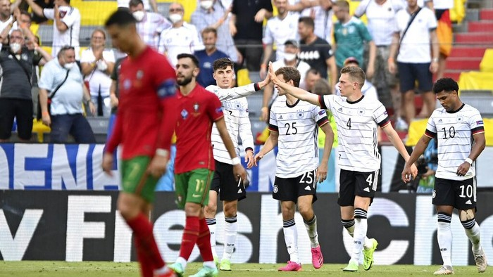 Germanys Kai Havertz, background left, celebrates after scoring his sides first goal during the Euro 2020 soccer championship group F match between Portugal and Germany at the Football Arena stadium in Munich, Germany, Saturday, June 19, 2021. (Philipp Guelland/Pool via AP)