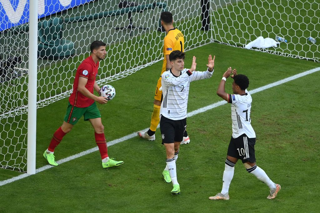 MUNICH, GERMANY - JUNE 19: Kai Havertz of Germany celebrates with Serge Gnabry after scoring their side's third goal during the UEFA Euro 2020 Championship Group F match between Portugal and Germany at Football Arena Munich on June 19, 2021 in Munich, Germany. (Photo by Matthias Hangst/Getty Images)