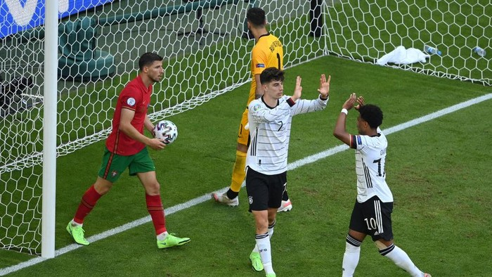 MUNICH, GERMANY - JUNE 19: Kai Havertz of Germany celebrates with Serge Gnabry after scoring their sides third goal during the UEFA Euro 2020 Championship Group F match between Portugal and Germany at Football Arena Munich on June 19, 2021 in Munich, Germany. (Photo by Matthias Hangst/Getty Images)