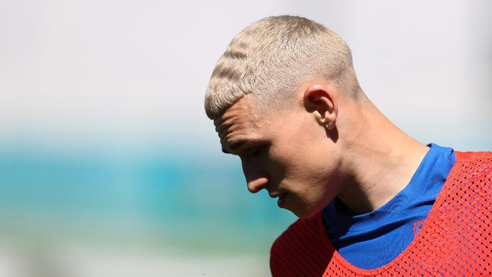 BURTON UPON TRENT, ENGLAND - JUNE 09: The new hair style of Phil Foden  during an England training session at St Georges Park on June 09, 2021 in Burton upon Trent, England. (Photo by Catherine Ivill/Getty Images)