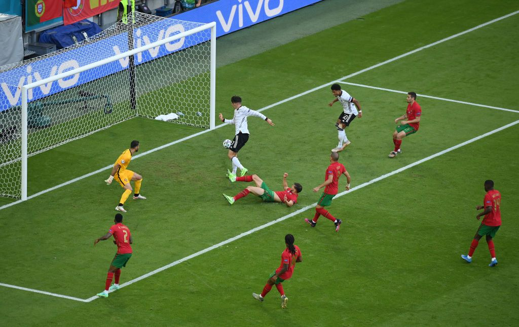 MUNICH, GERMANY - JUNE 19: Kai Havertz of Germany scores their side's third goal past Rui Patricio of Portugal during the UEFA Euro 2020 Championship Group F match between Portugal and Germany at Football Arena Munich on June 19, 2021 in Munich, Germany. (Photo by Alexander Hassenstein/Getty Images)