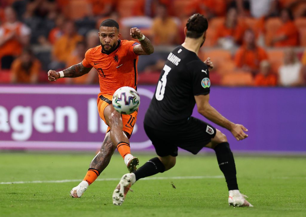 AMSTERDAM, NETHERLANDS - JUNE 17: Memphis Depay of Netherlands celebrates after scoring their side's first goal during the UEFA Euro 2020 Championship Group C match between the Netherlands and Austria at Johan Cruijff Arena on June 17, 2021 in Amsterdam, Netherlands. (Photo by Olaf Kraak - Pool/Getty Images)