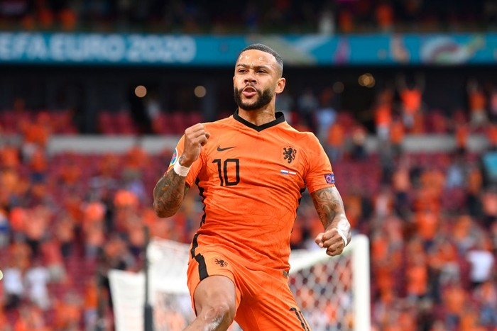 AMSTERDAM, NETHERLANDS - JUNE 17: Memphis Depay of Netherlands celebrates after scoring their sides first goal during the UEFA Euro 2020 Championship Group C match between the Netherlands and Austria at Johan Cruijff Arena on June 17, 2021 in Amsterdam, Netherlands. (Photo by Olaf Kraak - Pool/Getty Images)