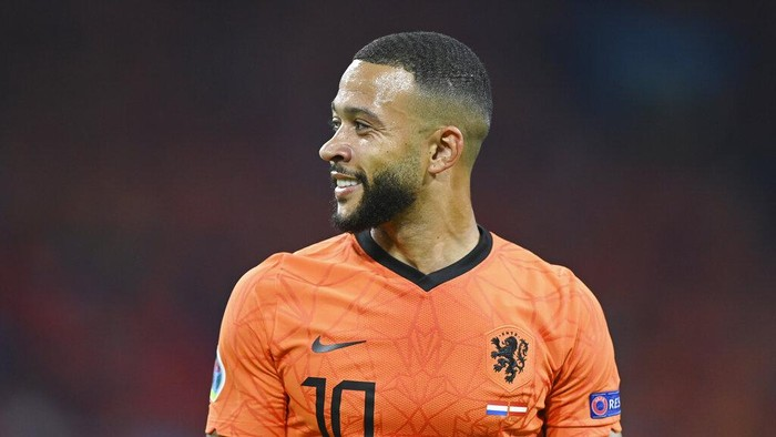 Memphis Depay of the Netherlands smiles during the Euro 2020 soccer championship group C match between the The Netherlands and Austria at Johan Cruijff ArenA in Amsterdam, Netherlands, Thursday, June 17, 2021. (John Thys, Pool via AP)
