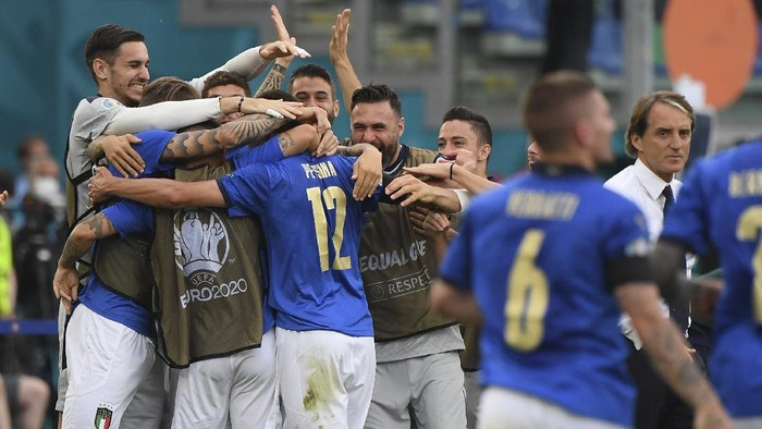 Italys Matteo Pessina (12) celebrates after scoring his sides opening goal during the Euro 2020 soccer championship group A match between Italy and Wales at the Stadio Olimpico stadium in Rome, Sunday, June 20, 2021. (Alberto Lingria/Pool via AP)