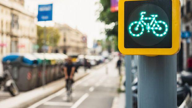 Bicycle Sign Traffic Light City Street People riding on Bike lane Ecology lifestyle Transportation