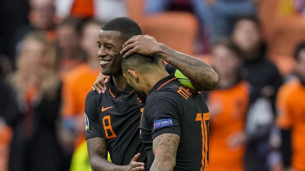 Georginio Wijnaldum of the Netherlands, left, and Memphis Depay of the Netherlands celebrate after scoring their team second goal during the Euro 2020 soccer championship group C match between The Netherlands and North Macedonia at the Johan Cruyff ArenA in Amsterdam, Netherlands, Monday, June 21, 2021. (AP Photo/Peter Dejong, Pool)