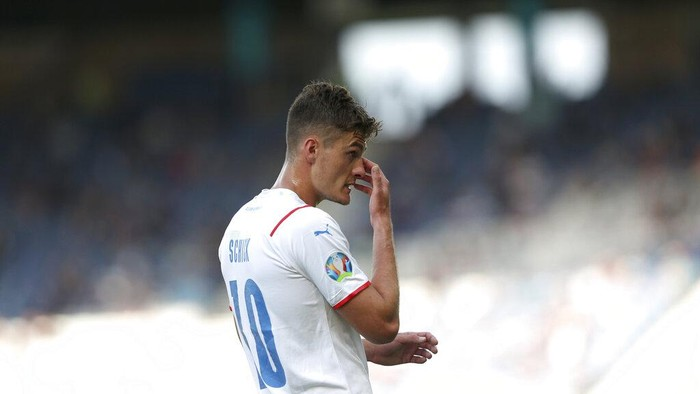 Czech Republics Patrik Schick touches his nose during the Euro 2020 soccer championship group D match between Croatia and the Czech Republic at the Hampden Park stadium in Glasgow, Friday, June 18, 2021. (Robert Perry, Pool via AP)