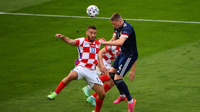 GLASGOW, SCOTLAND - JUNE 22: Scott McTominay of Scotland battles for a header with Nikola Vlasic of Croatia during the UEFA Euro 2020 Championship Group D match between Croatia and Scotland at Hampden Park on June 22, 2021 in Glasgow, Scotland. (Photo by Andy Buchanan - Pool/Getty Images)