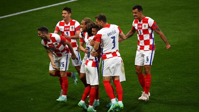 GLASGOW, SCOTLAND - JUNE 22: Ivan Perisic of Croatia celebrates with teammates after scoring their sides third goal during the UEFA Euro 2020 Championship Group D match between Croatia and Scotland at Hampden Park on June 22, 2021 in Glasgow, Scotland. (Photo by Andy Buchanan - Pool/Getty Images)