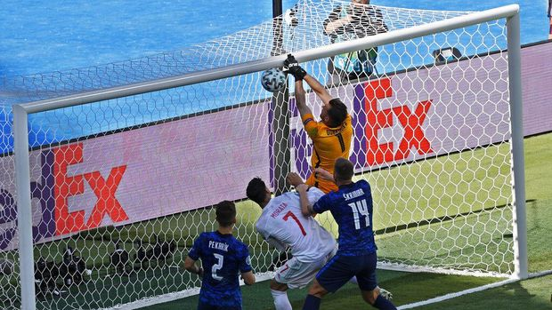 Slovakia's goalkeeper Martin Dubravka scores an own-goal while attempting to clear the ball during the Euro 2020 soccer championship group E match between Slovakia and Spain at La Cartuja Stadium in Seville, Spain, Wednesday June. 23, 2021. (Julio Munoz, Pool Photo via AP)