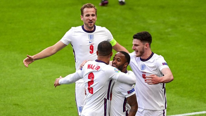 Englands Raheem Sterling, second right, is congratulated by teammates Englands Declan Rice, right, and Kyle Walker and Harry Kane, top, after scoring his team's first goal during the Euro 2020 soccer championship group D match between the Czech Republic and England at Wembley stadium, London, Tuesday, June 22, 2021.
