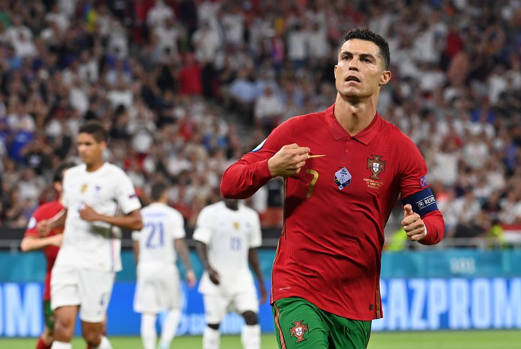 BUDAPEST, HUNGARY - JUNE 23: Cristiano Ronaldo of Portugal celebrates after scoring their side's first goal during the UEFA Euro 2020 Championship Group F match between Portugal and France at Puskas Arena on June 23, 2021 in Budapest, Hungary. (Photo by Tibor Illyes - Pool/Getty Images)