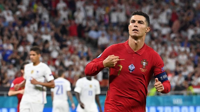BUDAPEST, HUNGARY - JUNE 23: Cristiano Ronaldo of Portugal celebrates after scoring their sides first goal during the UEFA Euro 2020 Championship Group F match between Portugal and France at Puskas Arena on June 23, 2021 in Budapest, Hungary. (Photo by Tibor Illyes - Pool/Getty Images)