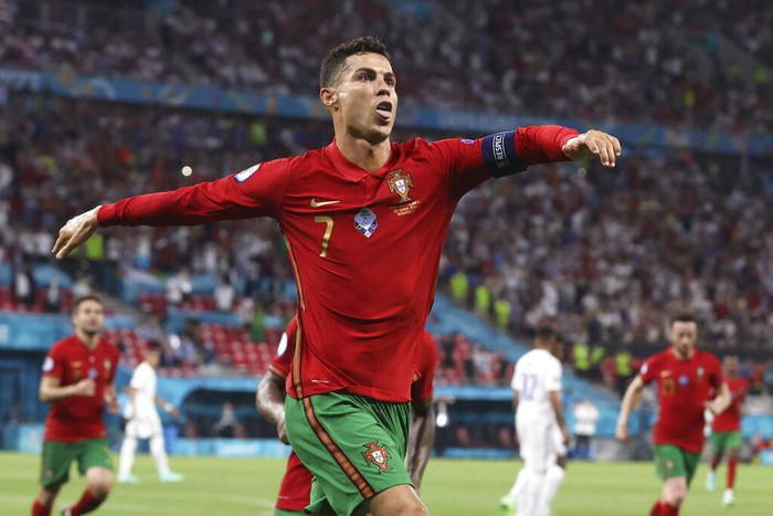 Portugals Cristiano Ronaldo celebrates after scoring his sides second goal during the Euro 2020 soccer championship group F match between Portugal and France at the Puskas Arena in Budapest, Wednesday, June 23, 2021. (Bernadett Szabo, Pool photo via AP)