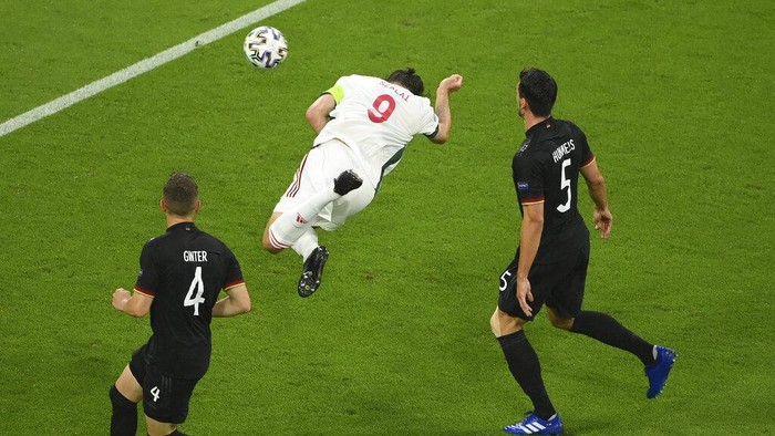 Hungarys Adam Szalai scores the opening goal during the Euro 2020 soccer championship group F match between Germany and Hungary at the football arena stadium in Munich, Germany, Wednesday, June 23, 2021. (Matthias Hangst/Pool Photo via AP)