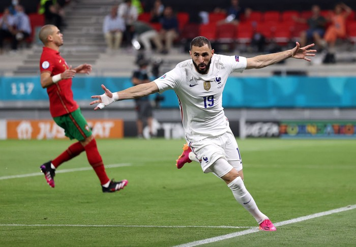 BUDAPEST, HUNGARY - JUNE 23: Karim Benzema of France celebrates after scoring their sides second goal during the UEFA Euro 2020 Championship Group F match between Portugal and France at Puskas Arena on June 23, 2021 in Budapest, Hungary. (Photo by Alex Pantling/Getty Images)